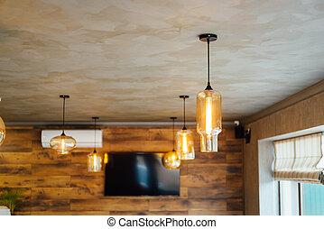 Set edison retro lamp on loft wooden wall background