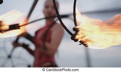 Set fire to a kerosene torch for a fire show. slow motion
