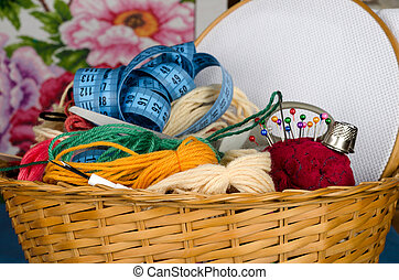 Set for cross stitching in a wicker basket