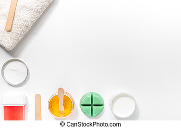 Set for depilation with wax on white background top view copyspace