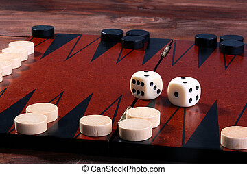 Set for game in a backgammon, a counter white and black, two cubes, a game field.