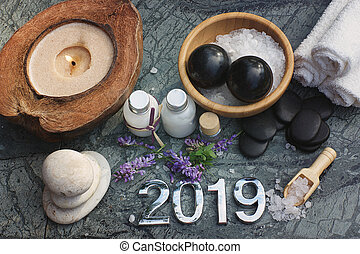 Set for spa procedures with numbers 2019 and all the necessary props for hot massage and aromatherapy