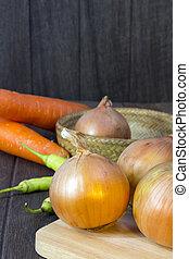 set fresh vegetables with green leaf on a wooden floor.