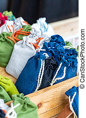 set herbalist cotton bag with fragrant herbs, dark blue, green and white in a wooden box