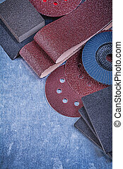 Set of abrasive materials on metallic background vertical view