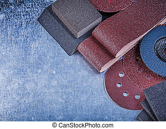 Set of abrasive tools on metallic background horizontal view