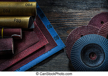 set of abrasive tools on vintage wood background