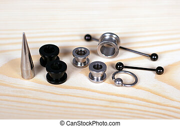 set of accessories for piercing on a wooden board