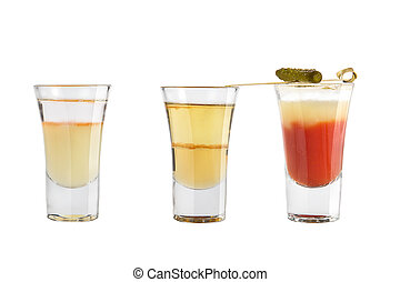 Set of alcohol shots on a white background. Three shots different with strong alcohol.