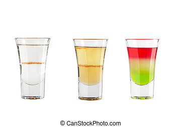 Set of alcohol shots on a white background. Three shots with different types of alcohol.