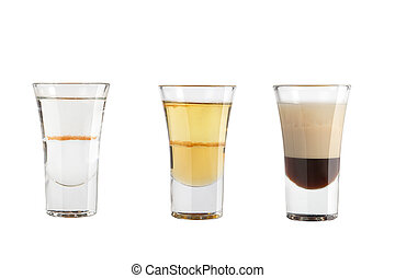 Set of alcohol shots on a white background. Three shots with different types of strong alcohol.