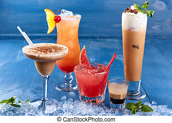 Set of alcoholic cocktails on blue background