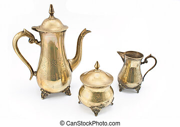Set of antique silver teapots on white