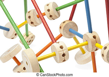 A set of assembled wooden tinker toys over the white background