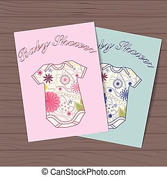 Set of baby showers with body dresses on wooden background