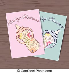 Set of baby showers with bottles on wooden background