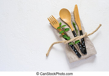 set of bamboo cutlery and napkin on a white background. Natural