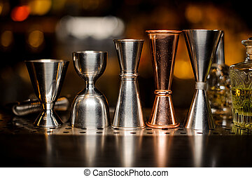 Set of barman equipment in a line on the bar counter