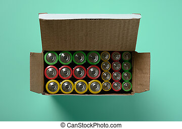 set of batteries on green background