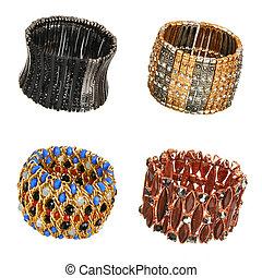 set of beautiful bracelets isolated on white
