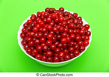 Set of beautiful red cherry in a glass dish