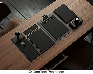Set of black branding elements on the table. 3d render