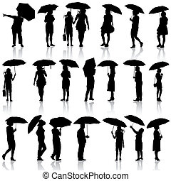 Set of black silhouettes of men and women with umbrellas. Vector illustration.