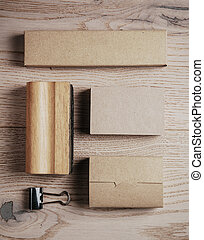 Set of blank classic office elements on the wooden background. Vertical