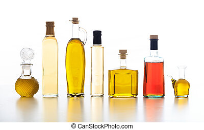 Set of bottles of olive oil and vinegar on white background