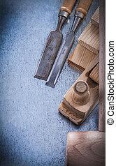 Set of carpenterâ??s tools on metallic background construction c