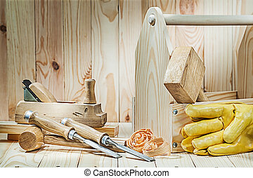 set of carpenter tools with wooden toolbox on wood background