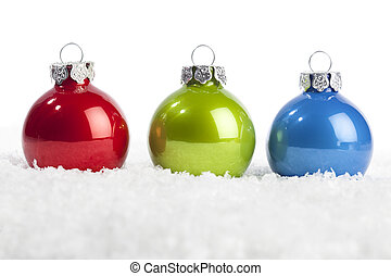 Set of christmas baubles in red, green, blue
