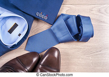 set of classic mens clothes - blue suit, shirts, brown...