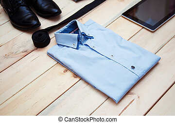 Set of clothes and accessories for man on wooden background