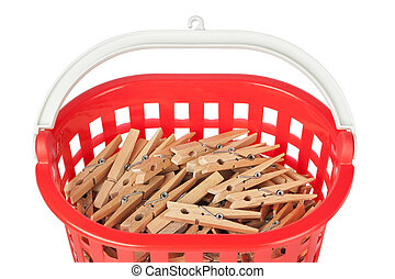 Set of clothespins in the red basket. Closeup.