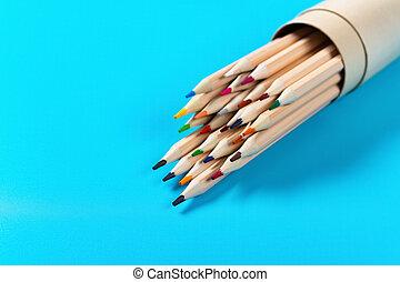 set of color pencils on a blue background