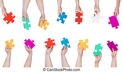 set of color puzzle pieces in people hands