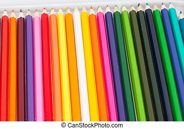 Set of colored pencils in a box on white background