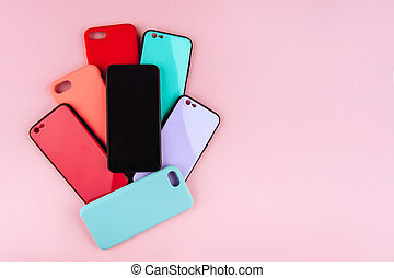 Set of colored plastic covers for smartphone isolated on a white background