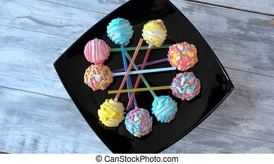 Set of colorful cake pops, top view. Assorted candies with frosting on sticks. Tasty and delicate filling.