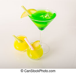 Set of colorful drinks, decorated with fruit, martini glass, shot glass