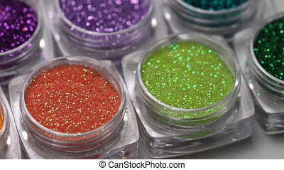 Set of colorful nail makeup glitter - Closeup set of...
