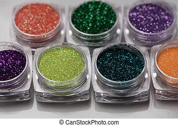 Set of colorful nail makeup glitter - Closeup set of...