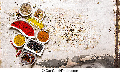 Set of colorful spices and herbs. On rustic background.