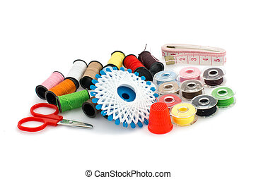 Set of colorful spools of thread isolated