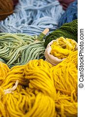 Set of colorful wool yarn balls. Closeup photo