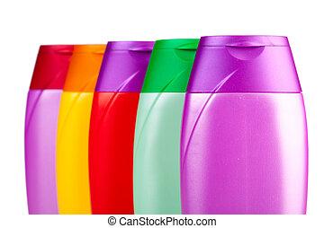 shampoo - Set of colour plastic bottles with shampoo on...