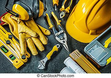 set of construction tools on black background