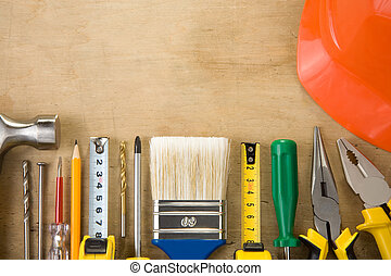 set of construction tools on wood background