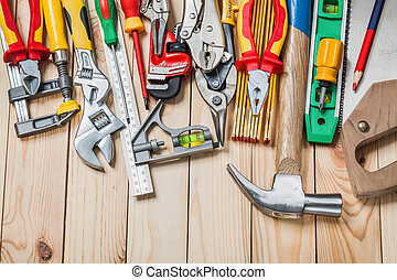 set of construction tools on wood boards